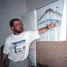 Glenn Teaching Liberian workers to build pads