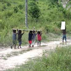 Orphans carrying Drilling Supplies in Gbargna, Liberia