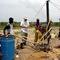 Jim training Liberian workers to build pads