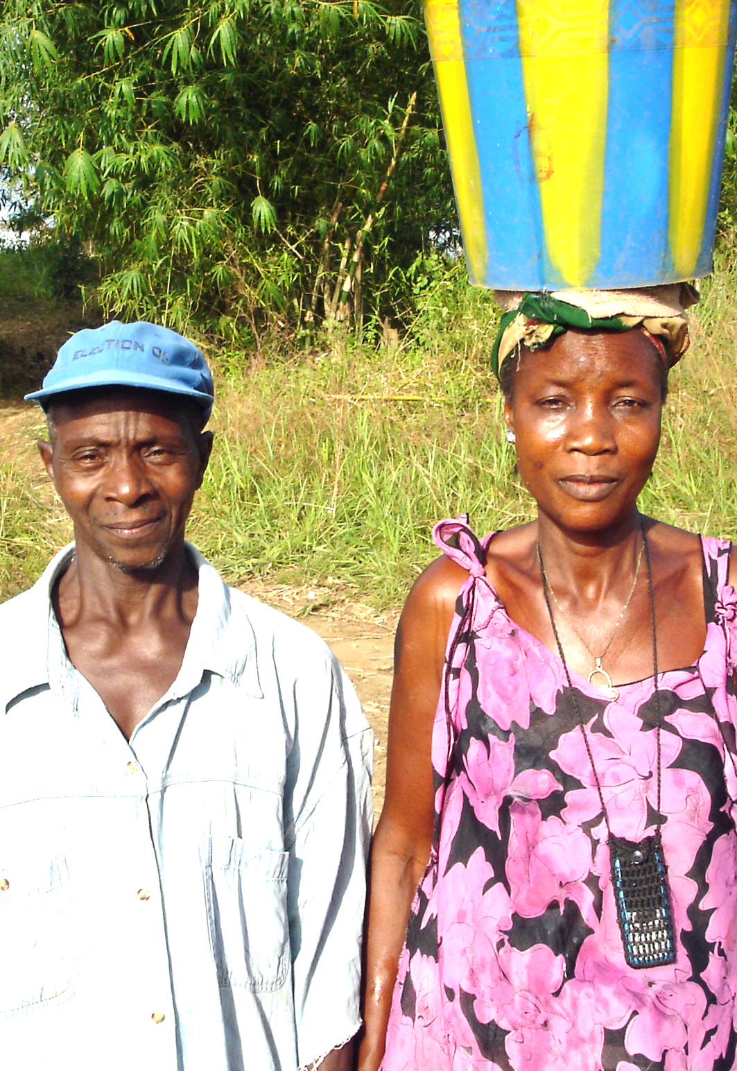 woman with bucket and husband.jpg 1 MB